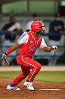 24 September 2009: Giorvis Duvergel of Cuba hits the ball during the 2009 Baseball World Cup final round match won 5-3 by Team USA over Cuba, in Nettuno, Italy.