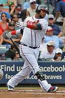 Atlanta Braves third baseman Juan Francisco #25 swings at a pitch during a game against the Colorado Rockies at Turner Field on September 3, 2012 in Atlanta, Georgia. The Braves  defeated the Rockies 6-1. (Tony Farlow/Four Seam Images).
