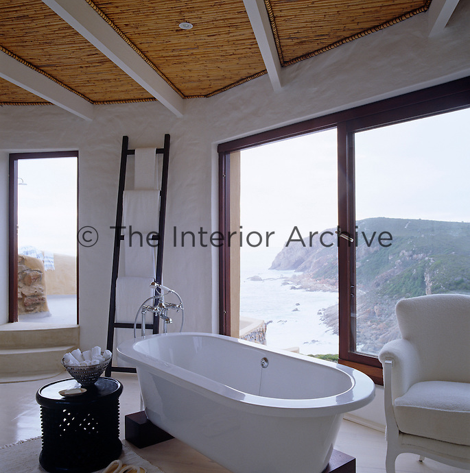 A contemporary bathroom with a spectacular view of the Indian Ocean