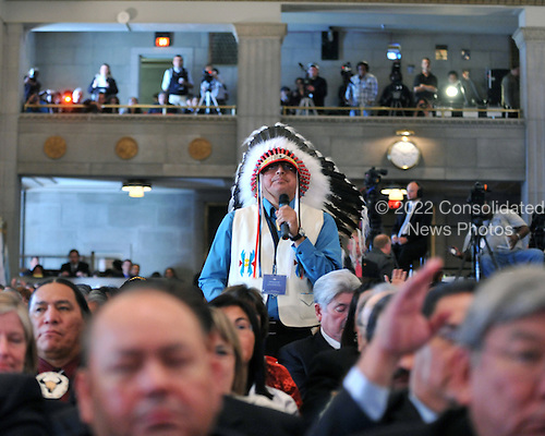 Washington, D.C. - November 5, 2009 -- Chairman Marcus Levings of the 3 Affiliated Tribes of the Berthold Reservation in North Dakota asks United States President Barack Obama a question during an interactive discussion with tribal leaders following the President's opening remarks at the White House Tribal Nations Conference at the U.S. Department of the Interior in Washington, D.C. on Thursday, November 5, 2009..Credit: Ron Sachs / Pool via CNP