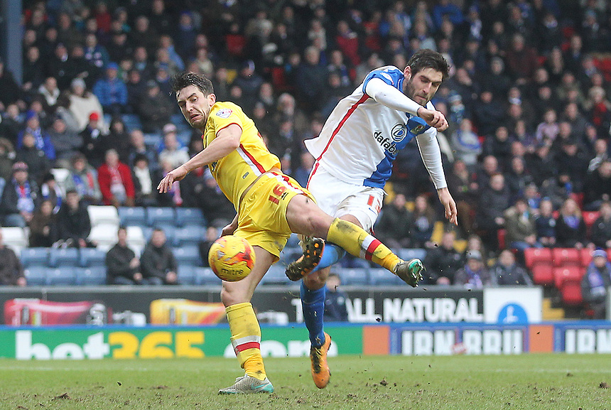 Blackburn Rovers Danny Graham gets a shot past Milton Keynes Dons Joe Walsh<br /> <br /> Photographer Mick Walker/CameraSport<br /> <br /> Football - The Football League Sky Bet Championship - Blackburn Rovers v Milton Keynes Dons - Saturday 27th February 2016 - Ewood Park - Blackburn<br /> <br /> &copy; CameraSport - 43 Linden Ave. Countesthorpe. Leicester. England. LE8 5PG - Tel: +44 (0) 116 277 4147 - admin@camerasport.com - www.camerasport.com