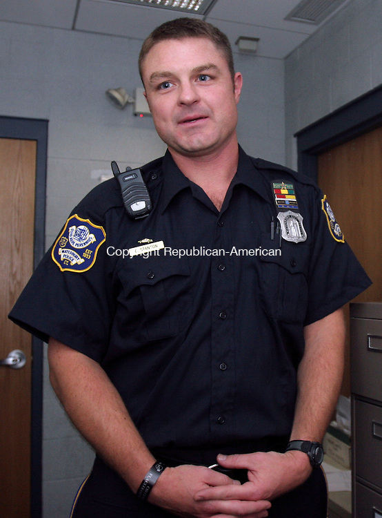 WATERBURY, CT-15September 2006-091506TK11- Waterbury Police Officer, Dan Stanton, sharing how the job tension grows as incoming calls are handled at the communications center.   Tom Kabelka Republican-American (Dan Stanton)