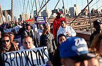 "NewYork, United States, October 25, 2011.Protesters affiliated with the Occupy Wall Street movement, march onto New York's Brooklyn Bridge in a ""day of solidarity"" in New York October 25, 2011. VIEWpress /Kena Betancur..Forty-three percent of Americans agree with the views of the ""Occupy Wall Street"" movement.Local media report.."