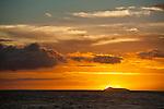 The sun setting behind Lehua Island, Kauai, Hawaii