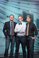 Oxy Wear models for the Fall 2015 issue of Occidental Magazine, from left: Christopher Gilman, Associate Director, Center for Digital Liberal Arts, Jacob Sargent, Associate Director, Center for Digital Liberal Arts and Daniel Chamberlain, Director, Center for Digital Liberal Arts. Photographed on Sept. 29, 2015 near the McKinnon Center for Global Affairs' media wall.<br /> (Photo by Marc Campos, Occidental College Photographer)