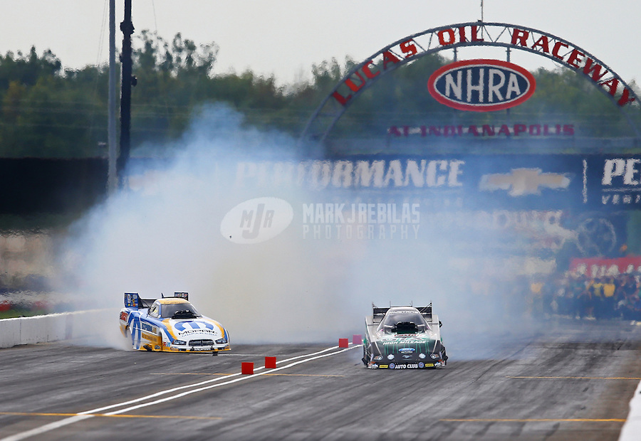 Sept. 1, 2014; Clermont, IN, USA; NHRA funny car driver Matt Hagan (left) goes sideways alongside John Force during the US Nationals at Lucas Oil Raceway. Mandatory Credit: Mark J. Rebilas-USA TODAY Sports
