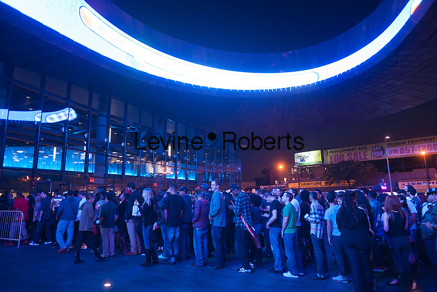 Crowds on line on opening night for the Barclays Center in Brooklyn in New York on Friday, September 28, 2012. The new venue opened with eight concerts by the rapper Jay-Z, a part owner in the arena, and is expected to be the major economic engine for a change in the neighborhood.   (© Richard B. Levine)