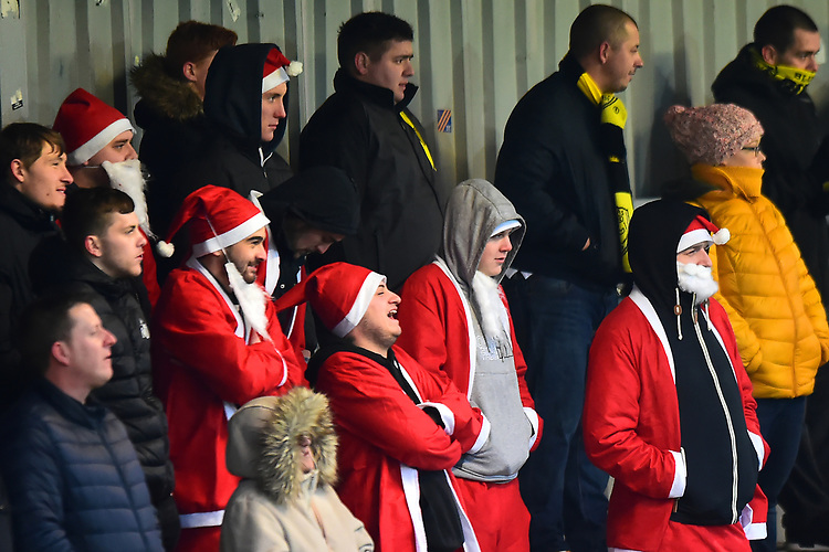 Burton Albion fans in Santa suits look on<br /> <br /> Photographer Richard Martin-Roberts/CameraSport<br /> <br /> The EFL Sky Bet League One - Saturday 15th December 2018 - Fleetwood Town v Burton Albion - Highbury Stadium - Fleetwood<br /> <br /> World Copyright © 2018 CameraSport. All rights reserved. 43 Linden Ave. Countesthorpe. Leicester. England. LE8 5PG - Tel: +44 (0) 116 277 4147 - admin@camerasport.com - www.camerasport.com