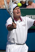 110506_MSFL_SMG<br /> <br /> DELRAY BEACH, FL - NOVEMBER 5, 2006: Former President George W. Bush flirts with tennis partner Anna Kournikova courtside at The annual Chris Evert / Raymond James Pro-Celebrity Tennis Classic which wrapped up Sunday at the Delray Beach Tennis Center. The event raised a record $1.4 million to fight drug abuse and assist neglected and abused children in South Florida, bringing the total raised by the popular event to $15.6 million since the event began 17 years ago.  Day two at the Delray Beach Tennis Center on November 5, 2006 in Delray Beach, Florida.   (Photo by Storms Media Group)<br /> <br /> People;  Former President Bush<br /> <br /> MUST CALL IN INTERESTED<br /> Michael Storms<br /> Storms Media Group Inc.<br /> (305) 632-3400 - Cell<br /> (305) 513-5783 - Fax<br /> MikeStorm@aol.com