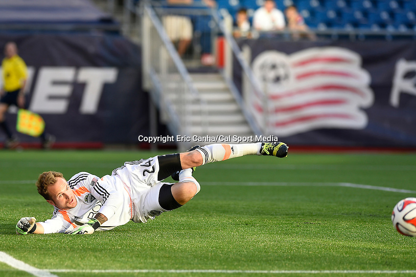 May 11, 2014 - Foxborough, Massachusetts, U.S. - Seattle Sounders FC goalkeeper Stefan Frei (24) dives to make a save during the MLS game between the Seattle Sounders FC and the New England Revolution held at Gillette Stadium in Foxborough Massachusetts.  New England defeated Seattle 5-0   Eric Canha/CSM