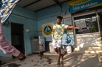 A customer carries a water can at a Safe Water Network iJal station in Rangsaipet, in Waragal, Telangana, Indiia, on Sunday, February 10, 2019. Photographer: Suzanne Lee for Safe Water Network