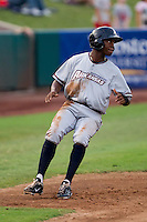 Rey Navarro (8) of the Northwest Arkansas Naturals rounds third base during a game against the Springfield Cardinals and the Springfield Cardinals at Hammons Field on July 30, 2011 in Springfield, Missouri. Springfield defeated Northwest Arkansas 11-5. (David Welker / Four Seam Images)