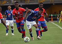 BOGOTÁ- COLOMBIA,25-05-2019:Christian Marrugo (Der.) jugador de Millonarios disputa el balón con Jose Ortiz (Izq.) jugador del  Deportivo Pasto durante el cuarto  partido de los cuadrangulares finales de la Liga Águila I 2019 jugado en el estadio Nemesio Camacho El Campín de la ciudad de Bogotá. /Christian Marrugo (R) player of Millonarios fights the ball  against ofJose Ortiz (L) player of Deportivo Pasto during the fourth match for the quarter finals B of the Liga Aguila I 2019 played at the Nemesio Camacho El Campin stadium in Bogota city. Photo: VizzorImage / Felipe Caicedo / Staff