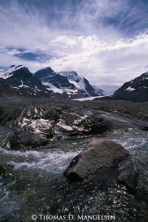 A river flows below a mountain range in Jasper National Park, Alberta, Canada.