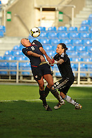 USA forward gets behind the defense of German goalkeeper Nadine Angerer to score a goal. The USA captured the 2010 Algarve Cup title by defeating Germany 3-2, at Estadio Algarve on March 3, 2010.