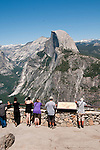 Tourists and Half Dome, from Glacier Point, Yosemite National Park, California, USA.  Photo copyright Lee Foster.  Photo # california122332