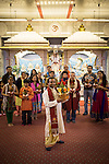 © Joel Goodman . 18 May 2013 . Gita Bhavan Hindu Temple , Withington Road , Whalley Range , Manchester . Acharya (instructor) Shyam Sunder Sharma  holds the pot in front of visitors . Commemorative service to celebrate the handover of the Green Kumbh Yatra (green journey pot or environmental pilgrimage) at the Gita Bhavan Hindu Temple in Manchester . The pot has travelled to the Maha Kumbh Mela , Kenya , Nepal and the Western Wall in Jerusalem along the way . At every place of rest an environmental action must be taken to reflect the pot's environmental significance . It's due to travel to Leicester and feature in an outdoor procession in London on 24th May 2013 . Photo credit : Joel Goodman