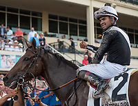 HALLANDALE BEACH, FL - March 31: Jockey Luis Saez all smiles in the winners circle after his win aboard Coach Rocks for Trainer Dale Romans after the Gulfstream Park Oaks at Gulfstream Park on March 31, 2018 in Hallandale Beach, FL. (Photo by Carson Dennis/Eclipse Sportswire/Getty Images.)