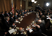 United States President George W. Bush speaks to the media regarding the economy prior to a Cabinet meeting in the Cabinet Room of the White House on October 15, 2008. <br /> Credit: Roger L. Wollenberg / Pool via CNP