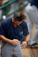Mobile BayBears coach David Newhan (11) after getting splashed with water during a Southern League game against the Montgomery Biscuits on May 2, 2019 at Riverwalk Stadium in Montgomery, Alabama.  Mobile defeated Montgomery 3-1.  (Mike Janes/Four Seam Images)
