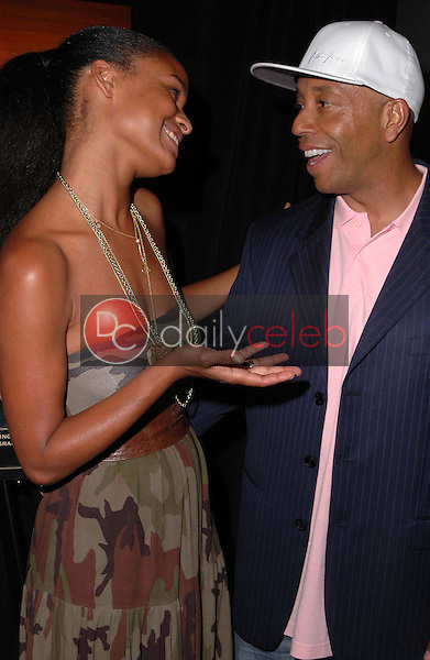 Joy Bryant and Russell Simmons<br />