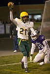 Manogue's Dontell Jackson (21) celebrates after make an interception in the end zone on Friday night, November 9, 2018 at Spanish Springs High School in Sparks, Nevada.
