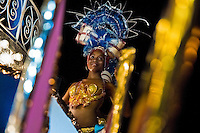 A young Cuban girl performs on the allegorical float during the Carnival in Santiago de Cuba, Cuba, 26 July 2008. Carnival in Santiago de Cuba is a large public celebration which is held - contrary to the other Latin American carnivals - in the summer. The carnival tradition dates back to the 17th century when the Spanish festival of Santiago (St. James) was mixed with street dancing parades of the Black African slaves. Nowadays comparsas, carnival groups of dancers and musicians, flow in the streets and perform popular music like salsa, rumba or reggaeton. In spite of the general lack of funds in Cuba (most of the festival costumes and floats are home-made) the Carnival is very lively and hot show with huge participation of the people of Santiago de Cuba.