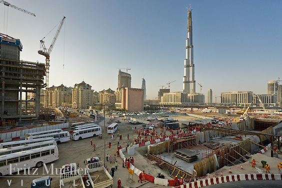 Buses wait to pick up foreign workers at the end of the shift at a construction site in Dubai