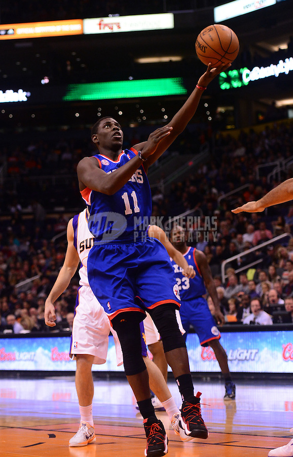 Jan. 2, 2013; Phoenix, AZ, USA: Philadelphia 76ers guard Jrue Holiday (11) lays up a ball in the first quarter against the Phoenix Suns at the US Airways Center. Mandatory Credit: Mark J. Rebilas-USA TODAY Sports