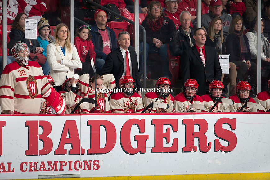 Wisconsin Badgers teammates look on from the bench during an NCAA college women's hockey game against the Minnesota Golden Gophers Saturday, February 15, 2014 in Madison, Wis. The Golden Gophers won 4-0. (Photo by David Stluka)