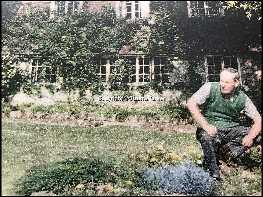 BNPS.co.uk (01202 558833)Pic: Strutt&Parker/BNPS<br /> <br /> HE Bates sat in the garden of the house that inspired The Darling Buds of May.<br /> <br /> Perfick!<br /> <br /> The Darling Buds of May fans can now get their hands on the house that inspired the hit TV show - on the market for the first time in 90 years.<br /> <br /> Author HE Bates, who wrote the books that inspired the ITV series about Pop Larkin and his family, lived at The Granary in the Kent village of Little Chart for more than 40 years.<br /> <br /> After his death, his son Richard Bates was executive producer for the TV adaptation and used the green outside this house to film many of the scenes with Catherine Zeta Jones, David Jason, Pam Ferris and the rest of the cast.<br /> <br /> The house is now on the market with Strutt & Parker for £1.1m.