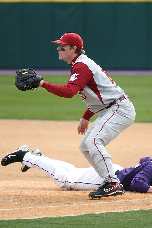Michael Weber, Washington State first baseman, waits for a pick-off throw during the Cougars Pac-10 conference baseball game against arch-rival Washington in Seattle, Washington, on April 3, 2010.