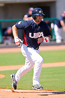 Tommy Mendonca #26 of the United States World Cup/Pan Am Team hustles down the first base line against Team Canada at the USA Baseball National Training Center on September 29, 2011 in Cary, North Carolina.  (Brian Westerholt / Four Seam Images)