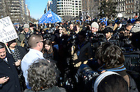 January 30, 2012  (Washington, DC)  A U.S Park Police Sergeant is surrounded by reporters and protestors alike.  The park was filed with news media, protestors, and bystanders waiting for police raid and eviction that did not come by the noon deadline imposed by the National Park Service.  (Photo by Don Baxter/Media Images International)