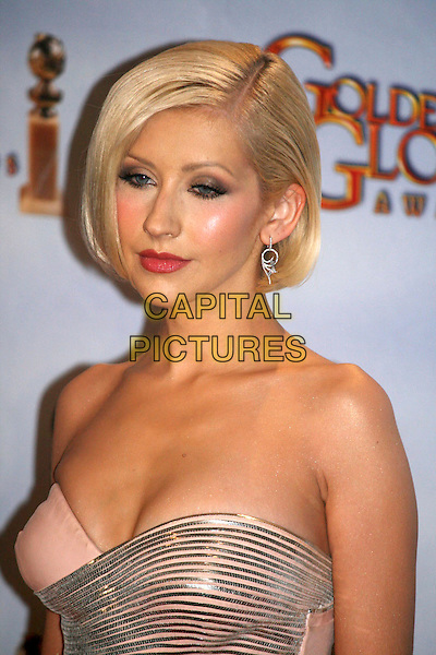 CHRISTINA AGUILERA .Press Room at the 67th Golden Globe Awards, he Beverly Hilton Hotel, Beverly Hills, California, USA, .January 17th, 201.globes pressroom hportrait headshot cleavage strapless silver peach nude shiny ribbed striped .CAP/AW/MAZ .©Maz/Weber/Capital Pictures