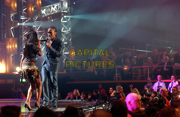 LEMAR & JAMELIA.Brit Awards 2005.Earls Court 2, London, SW5.February 9th, 2005.full length stage microphone singing music back behind rear skirt crowd audience.www.capitalpictures.com.sales@capitalpictures.com.©Capital Pictures
