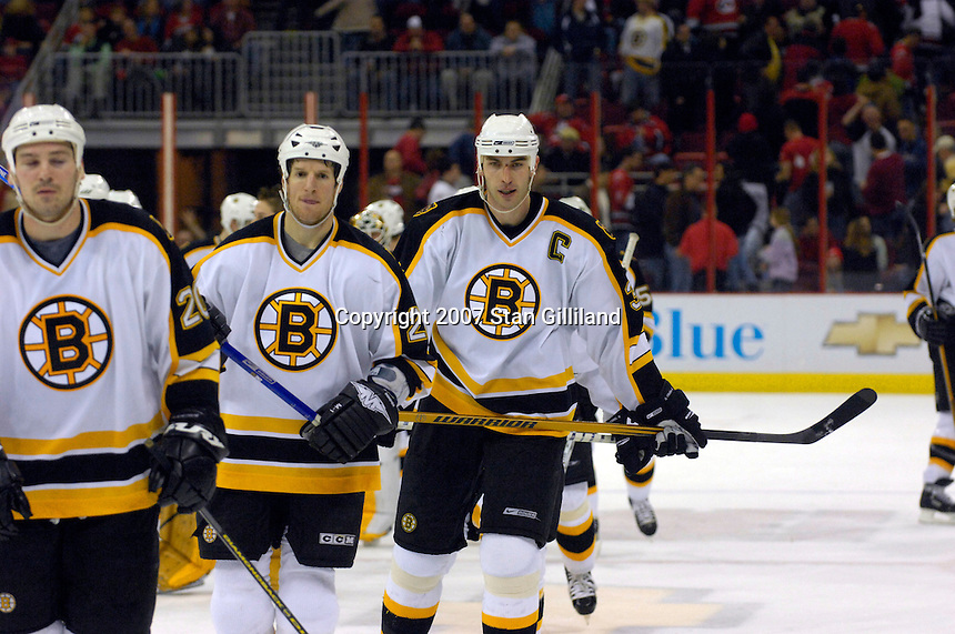 Boston Bruins' Zdeno Chara (33) skates off the ice with teammaates after his game winning goal against the Carolina Hurricanes Saturday, Feb. 3, 2007 at the RBC Center in Raleigh. Boston won 4-3 in overtime.
