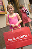 July 17, 2005: Jade Rossi, 7, of Wilmington, Illinois, stands outside the American Girl Place in downtown Chicago. Photo by Kevin J. Miyazaki/Redux for The New York Times