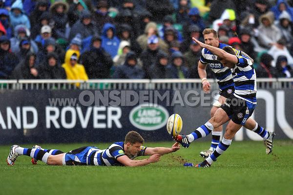 George Ford kicks for the posts with help from Ollie Devoto. Aviva Premiership match, between Bath Rugby and Newcastle Falcons on February 8, 2014 at the Recreation Ground in Bath, England. Photo by: Patrick Khachfe / Onside Images