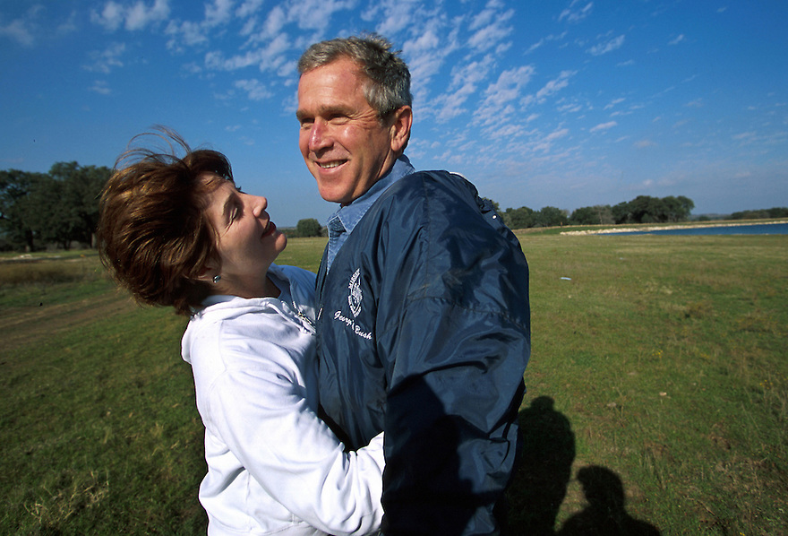 President George W Bush and his wife Laura on their Texas ranch, December 14, 2000.