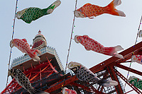A display of 333 Carp Flags, called Koinobori, flying at Tokyo Tower in celebration of Children's Day, Tokyo, Japan. Monday April 22nd 2019. Children's' Day is held on May 5th each year. Families decorate their houses with these carp-shaped flags to celebrate the health and growth of their children.  This display of 333 carp-flags (the number of metres  in the height of Tokyo Tower) runs from March 29 to May 6.