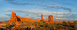 Panoramic image of Balanced Rock in Arches National Park with the La Sal Mountains in the background, taken in late afternoon.
