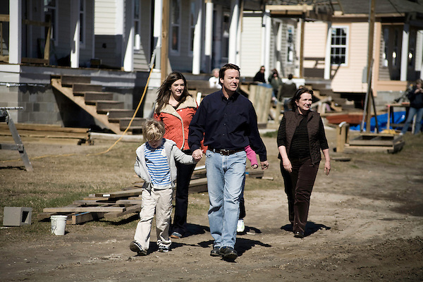 January 30, 2008. New Orleans, LA.. Former US Senator and presidential hopeful John Edwards bowed out of the presidential race today in New Orleans, where he had announced his presidential run in 2007. He spoke at the Musicians Village, a housing community being built in the 9th Ward by Habitat for Humanity.. Edwards was joined by (left to right) his son Jack, daughter Cate, and wife Elizabeth.