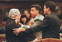 TALLAHASSEE, FL. 4/9/98-Reps. Jorge Rodriguez-Chomat, R-Miami, left, and Carlos Valdes, R-Miami, scuffle on the floor of the House of Representatives as Rep. Bruno Barreiro, R-Miami Beach, right, tries to intervene Thursday at the Capitol in Tallahassee. Earlier during debate over the School Readiness Voucher Program bill Valdes pointed out that Rodriguez-Chomat's children attend a private school.  Rodriguez-Chomat took exception to the comments and said he felt the statements overly personalized the debate. COLIN HACKLEY PHOTO