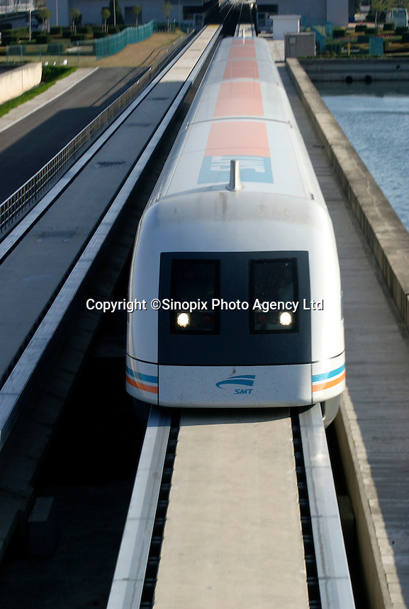 A Shanghai Transrapid magnetic levitation train pulls out of its station in Shanghai, China. Able to reach a top speed of 430 kilometers per hour, the Transrapid completes the 30 kilometers journey between the Pudong International Airport and the  Longyang Metro Station in just over 7 minutes. Still under its testing, the line will be in full operation early next year and expects to carry 10 million passengers per year by 2005..23-NOV-03