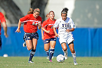 2 October 2011:  FIU's Kim Lopez (7) moves the ball upfield while being pursued by South Alabama's Shawn Meach (54) and Kristin Sutton (11) in the second half as the FIU Golden Panthers defeated the University of South Alabama Jaguars, 2-0, at University Park Stadium in Miami, Florida.