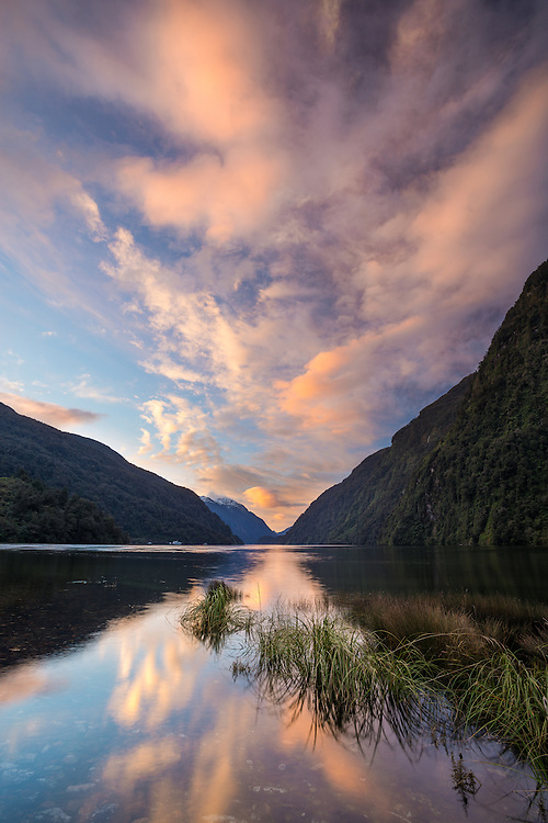 Dramatic sunset clouds reflected in Doubtful Sound. Fiordland National Park, New Zealand - stock photo, canvas, fine art print