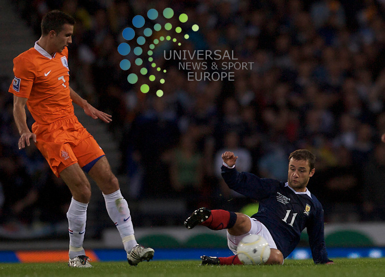 Scotland  v  Holland .2010 World Cup Qualifying Group 9 Match..09/09/09.Scotlands Shaun Malloney slides in on Hollands Van Persie . , during  tonights crucial World Cup qualifying match between Scotland and Holland...At Hampden Park Stadium, in Glasgow tonight...Picture by Mark Davison / Universal News & Sport
