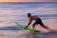 Blurred motion shot of Surfer entering the ocean, Hawaii