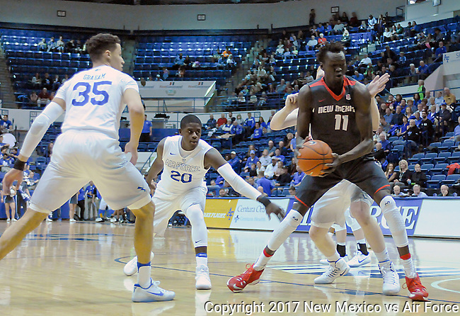 February 8, 2017:  New Mexico center, Obij Aget #11, works toward the basket during the NCAA basketball game between the New Mexico Lobos and the Air Force Academy Falcons, Clune Arena, U.S. Air Force Academy, Colorado Springs, Colorado.  New Mexico defeats Air Force 74-67.
